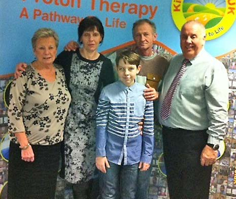 Adrian Secareanu and his parents with members from Kids'n'Cancer